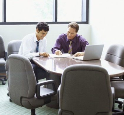Businessmen in Meeting --- Image by © Royalty-Free/Corbis
